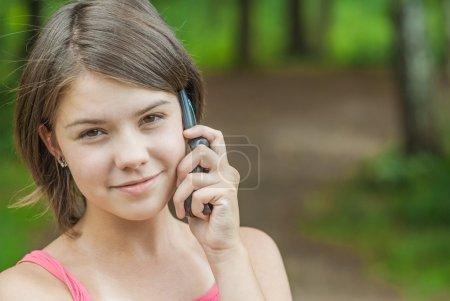 Girl speaks on cellular telephone