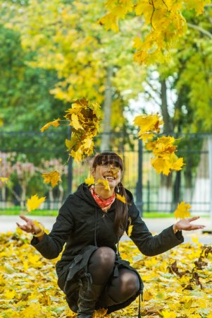 Young woman against autumn nature