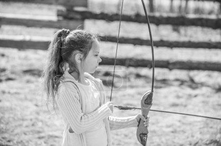 little girl shoots bow