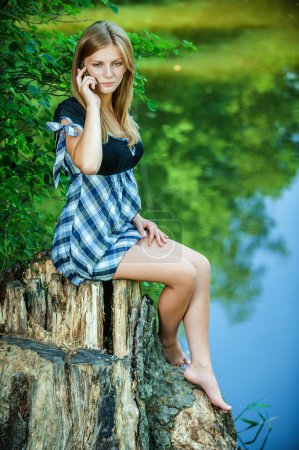 beautiful woman talks by mobile phone