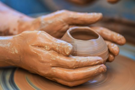 Hands of young potter