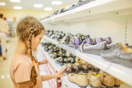 Little girl chooses shoes