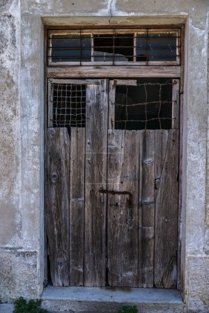 Old wooden door in ancient beautiful building