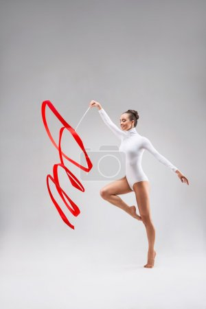 Photo for Beautiful gymnast tape in the studio - Royalty Free Image