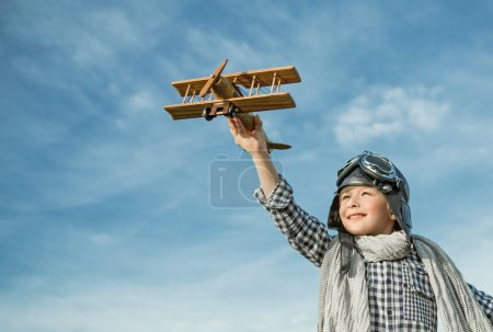 Boy boy with airplane