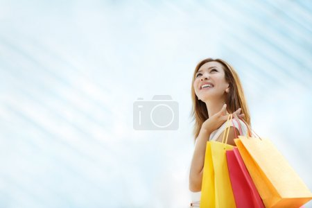 Photo for Young girl with shopping bag in the store - Royalty Free Image