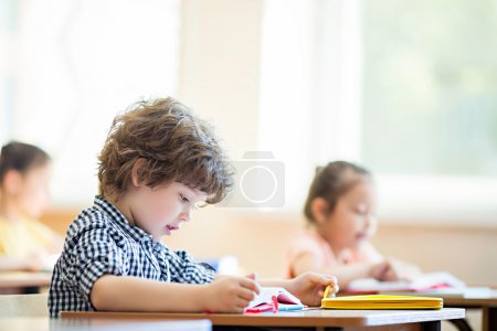 Studying boy in classroom