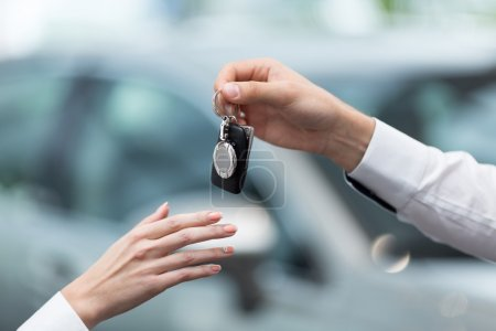 Hands with car keys