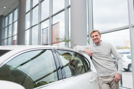 Young attractive man at the car