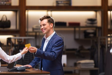Young businessman with credit card