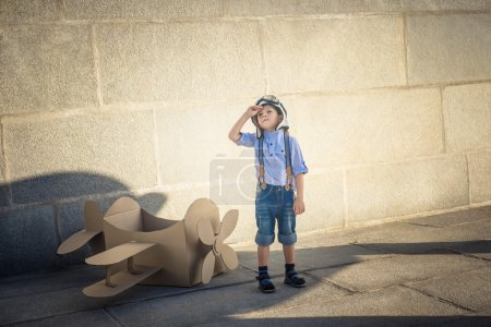 Photo for Little boy with a cardboard airplane - Royalty Free Image