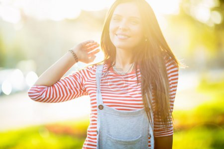 Photo for Smiling young woman in summer - Royalty Free Image