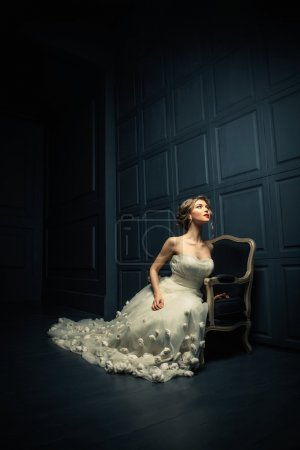 Photo for Beautiful girl in a white dress in studio - Royalty Free Image