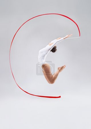 Photo for Jumping girl with tape in the studio - Royalty Free Image