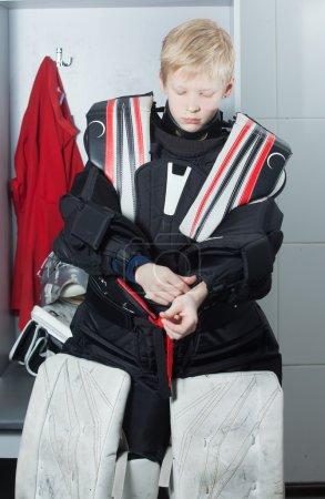 Young boy in goalie uniform