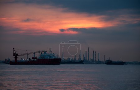 Sunset view  of Vessels on road. Singapore strait.