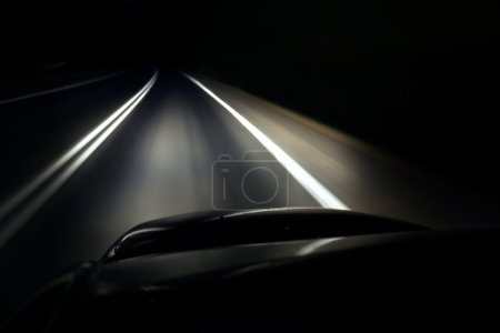 Lonely driving a car at night on the highway