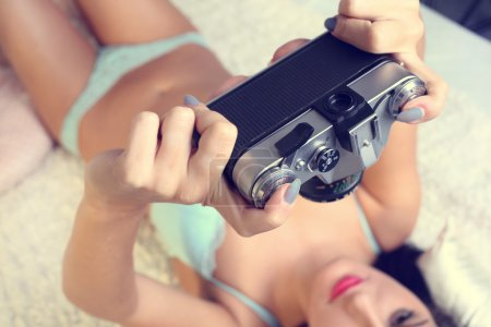 girl doing herself a picture of an old camera