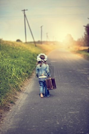 girl with a suitcase goes on an adventure