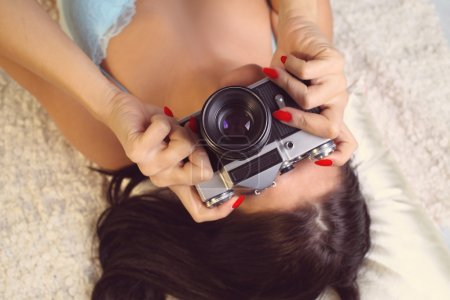 Girl in lingerie takes a photo