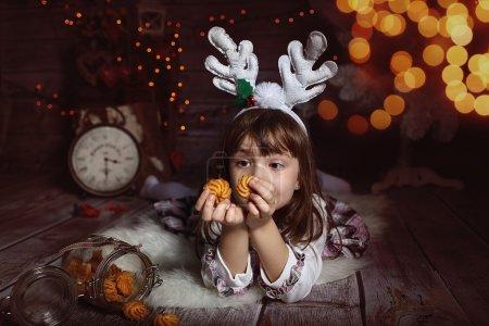 A girl waiting for santa eats cookies