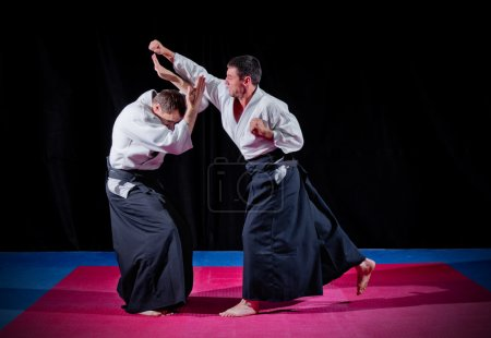 Photo for Two martial arts fighters on black - Royalty Free Image