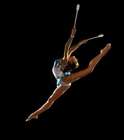 Girl engaged art gymnastics
