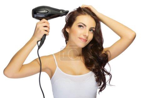 Photo pour Jeune fille avec un sèche-cheveux isolé - image libre de droit