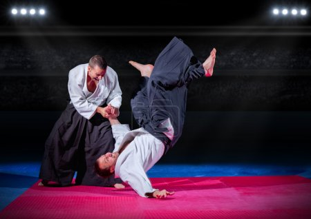 Photo for Two martial arts fighters at sports hall - Royalty Free Image