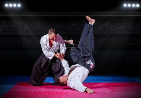Photo for Fight between two martial arts fighters at sports hall - Royalty Free Image