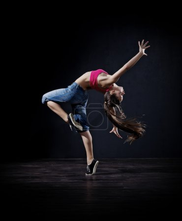 Photo for Young girl modern dancer (dark version) - Royalty Free Image