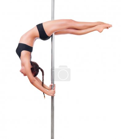 Woman engaged in pole dancing