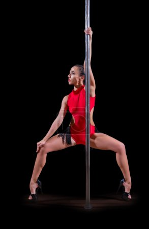 Photo for Pole dancer isolated on black - Royalty Free Image