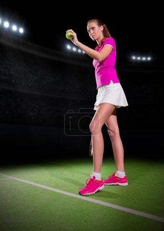 Photo for Young woman tennis player on stadium - Royalty Free Image