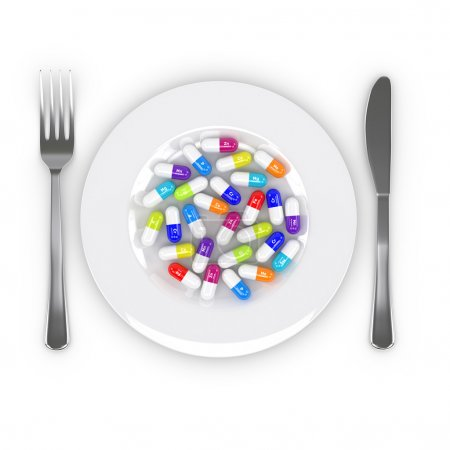 3d rendering of dietary supplements on plate isolated over white