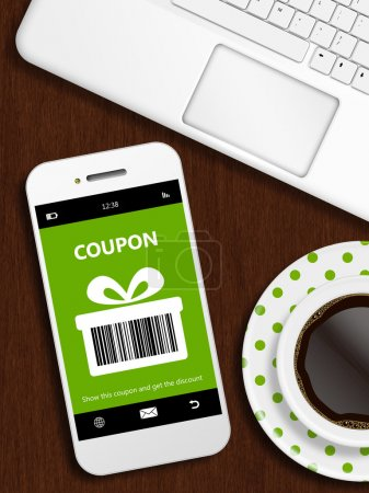 mobile phone with spring discount coupon, laptop and cup of coff