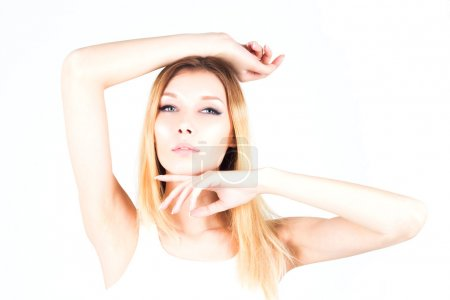 Beautiful woman on a white background with her hand raised. Waxing epilation. Shugaring results. Beauty concept.