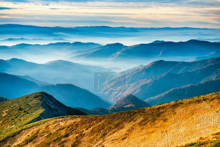 Photo for Lanscape with blue mountains and yellow hills - Royalty Free Image