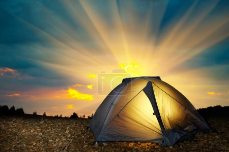 Photo for Illuminated yellow camping tent under stars at night. Instagram like filter - Royalty Free Image