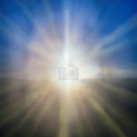 Photo for Abstract sunset- shining sun with sunbeams on the blue sky background - Royalty Free Image