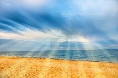 Sun shining above tropical beach