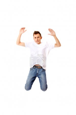 Young guy jumping from happiness