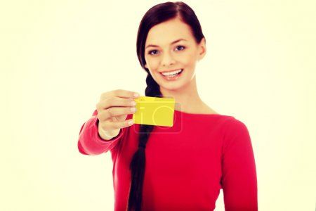Photo for Young woman holding empty business card. - Royalty Free Image