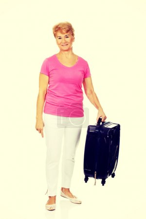 Photo for Smile senior woman with suitcase. - Royalty Free Image