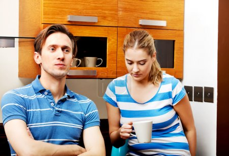 Photo for Young unhappy couple after quarrel in kitchen. - Royalty Free Image
