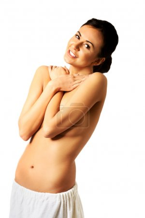 Topless woman wrapped in towel