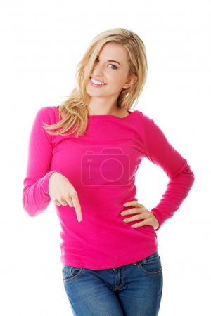 Casual woman presenting a copyspace.