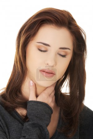 Young woman with terrible throat pain