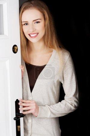 Woman opening her house door