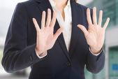 Beautiful caucasian business woman showing stop gesture.